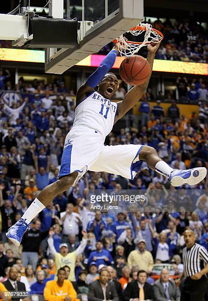 John Wall of the Kentucky Wildcats dunks against the Tennessee Volunteers during the semirfinals of the SEC Men's Basketball Tournament at the...