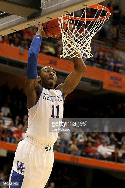 John Wall of the Kentucky Wildcats dunks in the second half against the Cornell Big Red during the east regional semifinal of the 2010 NCAA men's...