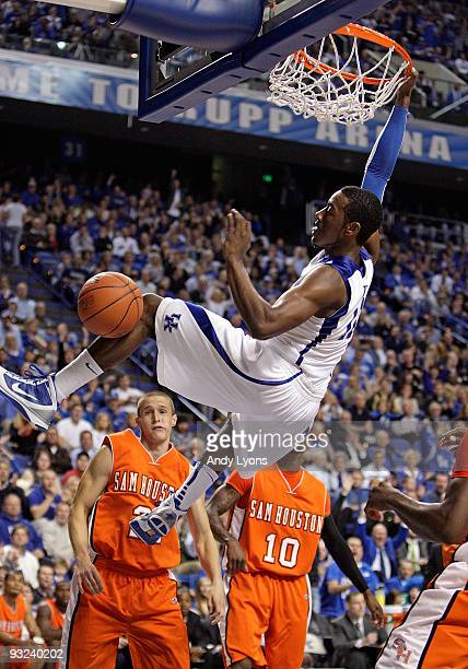 John Wall of the Kentucky Wildcats dunks the ball during the game against the Sam Houston State Bearkats at Rupp Arena on November 19 2009 in...