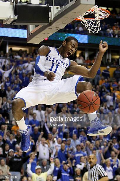 John Wall of the Kentucky Wildcats reacts after he completed a dunk against the Tennessee Volunteers during the semirfinals of the SEC Men's...