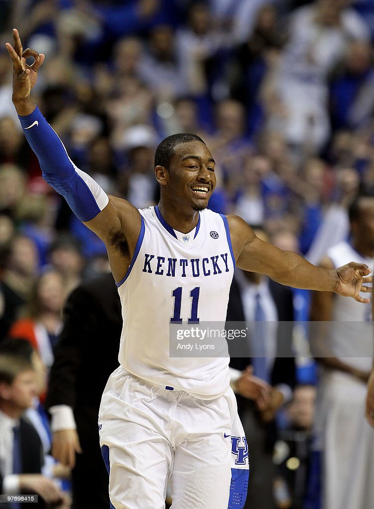 John Wall #11 of the Kentucky Wildcats reacts after he made a 3-point basket with less then :30 seconds to go in overtime against the Mississippi State Bulldogs during the final of the SEC Men's Basketball Tournament at the Bridgestone Arena on March 14, 2010 in Nashville, Tennessee.