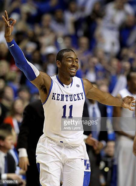 John Wall of the Kentucky Wildcats reacts after he made a 3-point basket with less then :30 seconds to go in overtime against the Mississippi State...