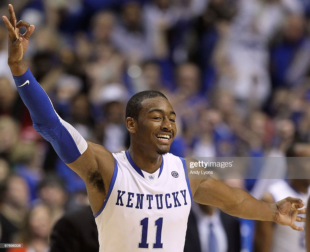 John Wall #11 of the Kentucky Wildcats reacts after he made a basket in overtime against the Mississippi State Bulldogs during the final of the SEC Men's Basketball Tournament at the Bridgestone Arena on March 14, 2010 in Nashville, Tennessee.