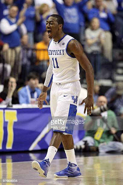 John Wall of the Kentucky Wildcats reacts in the second half against the Alabama Crimson Tide during the quarterfinals of the SEC Men's Basketball...