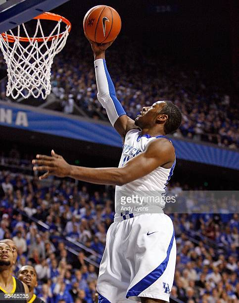John Wall of the Kentucky Wildcats shoots the ball during the game against the Long Beach State 49ers at Rupp Arena on December 23, 2009 in...