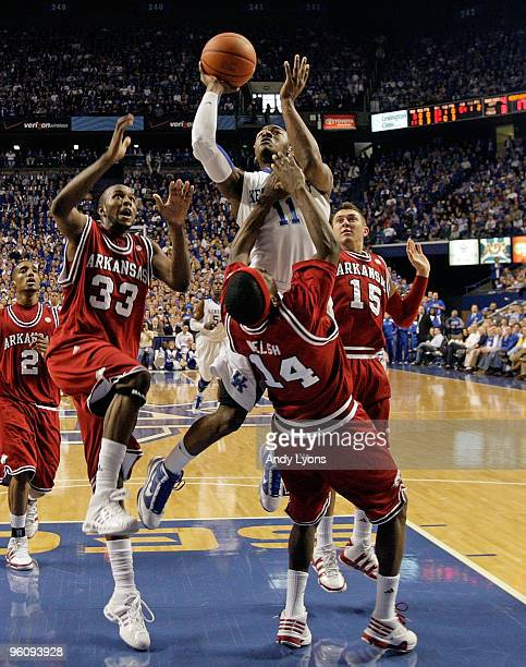 John Wall of the Kentucky Wildcats shoots the ball over Stefan Welsh of the Arkansas Razorbacks during the SEC game on January 23, 2010 at Rupp Arena...