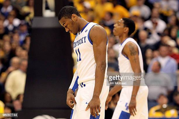 John Wall of the Kentucky Wildcats walks on the court with his head down against the West Virginia Mountaineers during the east regional final of the...