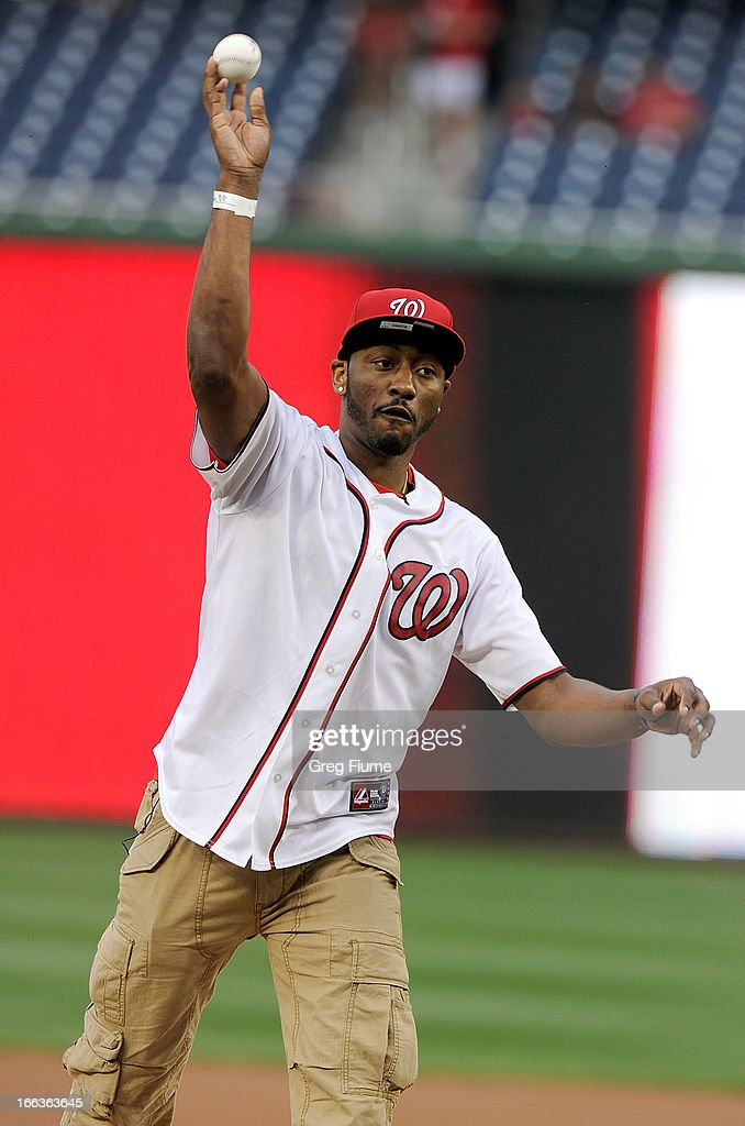 John Wall of the NBA Washington Wizards throws out the first pitch before the game between the Washington Nationals and the Chicago White Sox at Nationals Park on April 11, 2013 in Washington, DC.
