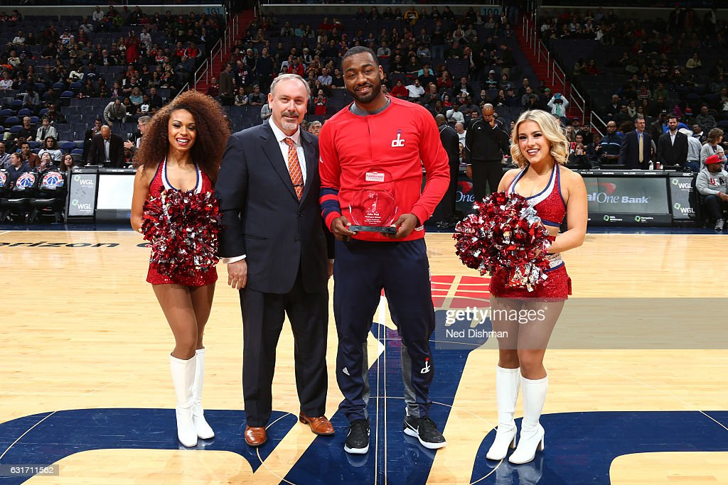 John Wall #2 of the Washington Wizards accepts the award of Kia Player of the Month for December of 2017 before the game of the Washington Wizards and the Philadelphia 76ers on January 14, 2017 at Verizon Center in Washington, DC.