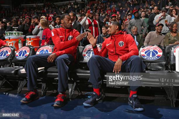 John Wall of the Washington Wizards and Bradley Beal of the Washington Wizards high five before the game against the Cleveland Cavaliers on December...