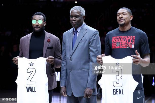 John Wall of the Washington Wizards and Bradley Beal of the Washington Wizards pose with their NBA All Star jerseys with former player Bob Dandridge...