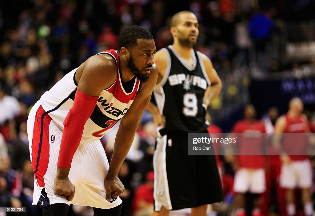 John Wall #2 of the Washington Wizards and Tony Parker #9 of the San Antonio Spurs look during the second half of the Wizards 101-93 win over the Spurs at Verizon Center on January 13, 2015 in Washington, DC.