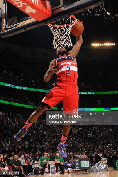 John Wall of the Washington Wizards attempts a dunk during the Sprite Slam Dunk Contest on State Farm AllStar Saturday Night as part of the 2014...