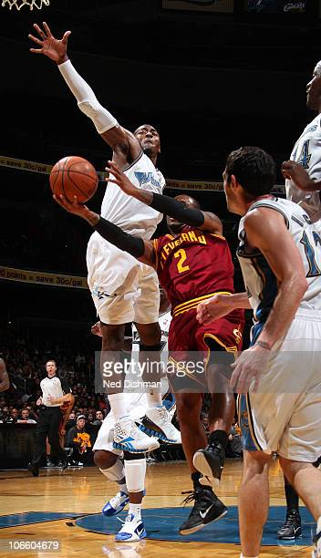 John Wall of the Washington Wizards blocks a shot against Mo Williams of the Cleveland Cavaliers at the Verizon Center on November 6 2010 in...