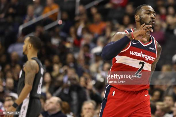 John Wall of the Washington Wizards celebrates a threepoint basket against the Brooklyn Nets during the second half at Capital One Arena on December...