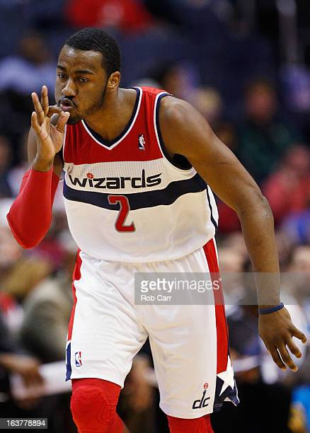 John Wall of the Washington Wizards celebrates after hitting a three pointer against the New Orleans Hornets during the first half at Verizon Center...