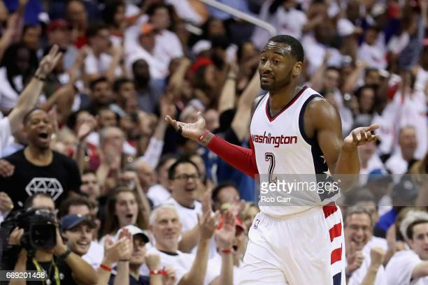 John Wall of the Washington Wizards celebrates after hitting a three pointer in the second half of the Wizards 114107 win over the Atlanta Hawks in...