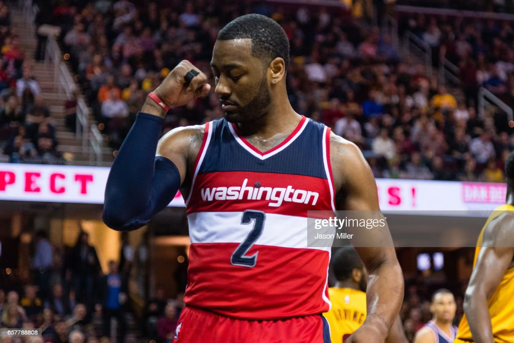 John Wall #2 of the Washington Wizards celebrates after scoring during the first half against the Cleveland Cavaliers at Quicken Loans Arena on March 25, 2017 in Cleveland, Ohio.