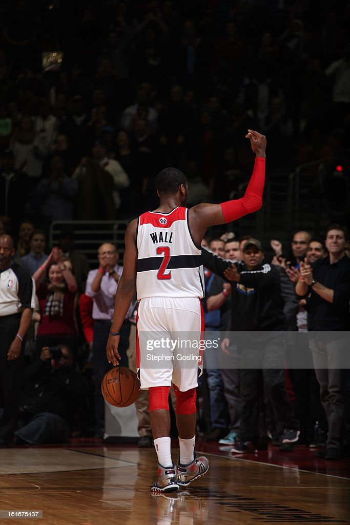 John Wall #2 of the Washington Wizards celebrates after the game against the Memphis Grizzlies at the Verizon Center on March 25, 2013 in Washington, DC.