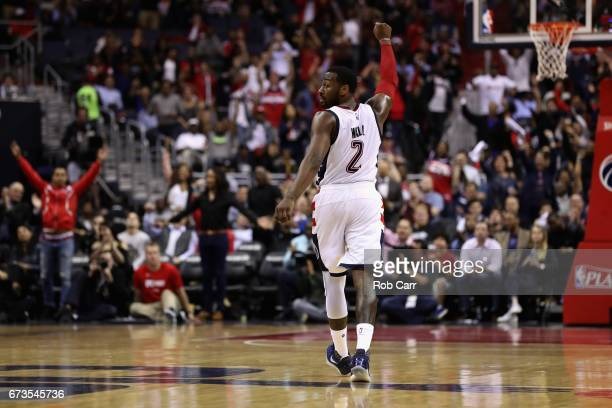 John Wall of the Washington Wizards celebrates after the Wizards scored in the first half against the Atlanta Hawks in Game Five of the Eastern...