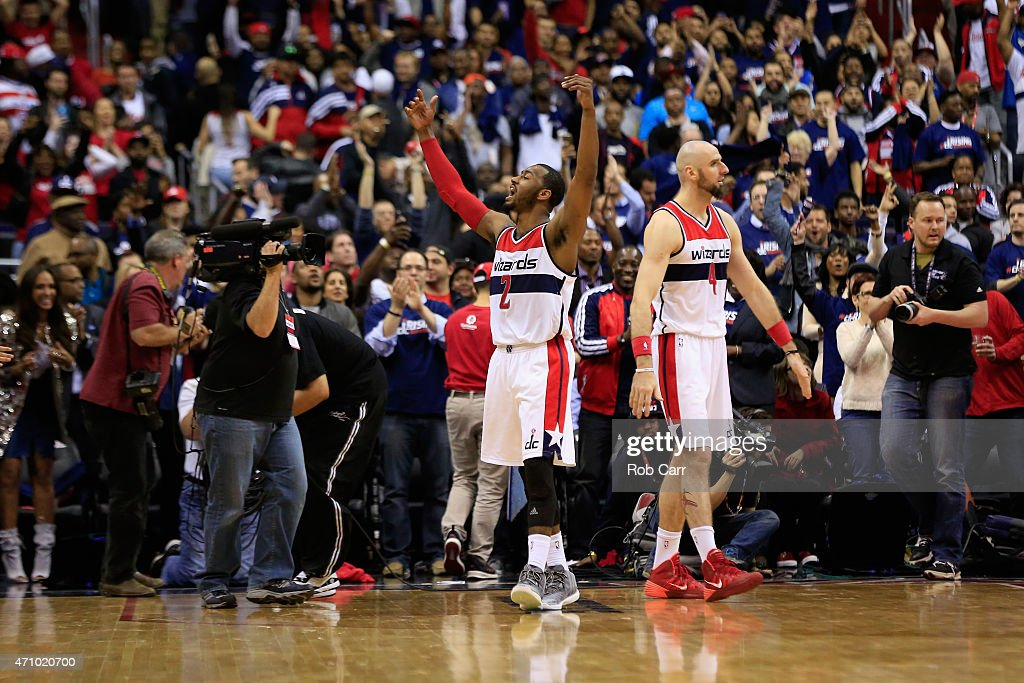 John Wall #2 of the Washington Wizards celebrates during the closing seconds of their 106-99 win over the Toronto Raptors during Game Three of the Eastern Conference Quarterfinals of the NBA playoffs at Verizon Center on April 24, 2015 in Washington, DC.