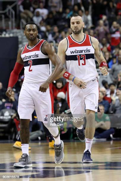John Wall of the Washington Wizards celebrates in front of Marcin Gortat after scoring against the Utah Jazz in the second half at Capital One Arena...