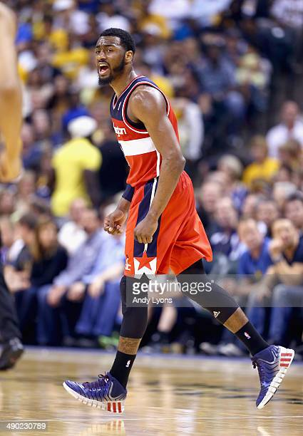 John Wall of the Washington Wizards celebrates in the 10279 win over the Indiana Pacers in Game 5 of the Eastern Conference Semifinals during the...