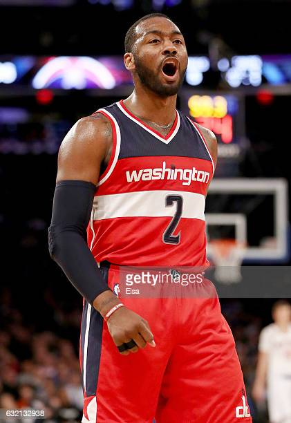 John Wall of the Washington Wizards celebrates in the fourth quarter against the New York Knicks at Madison Square Garden on January 19, 2017 in New...