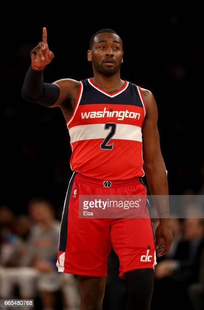 John Wall of the Washington Wizards celebrates in the fourth quarter against the New York Knicks at Madison Square Garden on April 6 2017 in New York...