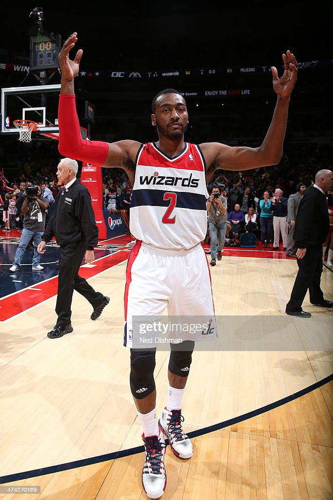 John Wall #2 of the Washington Wizards celebrates the win against the New Orleans Pelicans during the game at the Verizon Center on February 22, 2014 in Washington, DC.