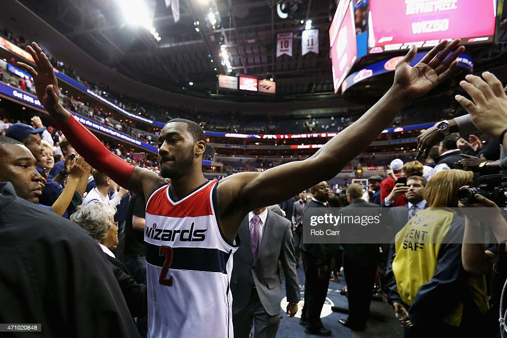 John Wall #2 of the Washington Wizards celebrates their 106-99 win over the Toronto Raptors during Game Three of the Eastern Conference Quarterfinals of the NBA playoffs at Verizon Center on April 24, 2015 in Washington, DC.