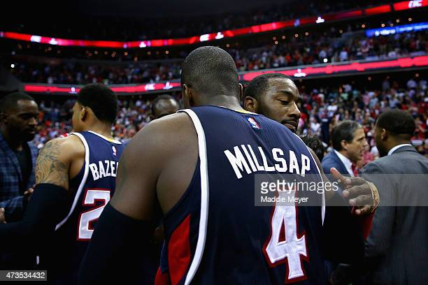 John Wall of the Washington Wizards congratulates Paul Millsap of the Atlanta Hawks after their playoff game at Verizon Center on May 15 2015 in...