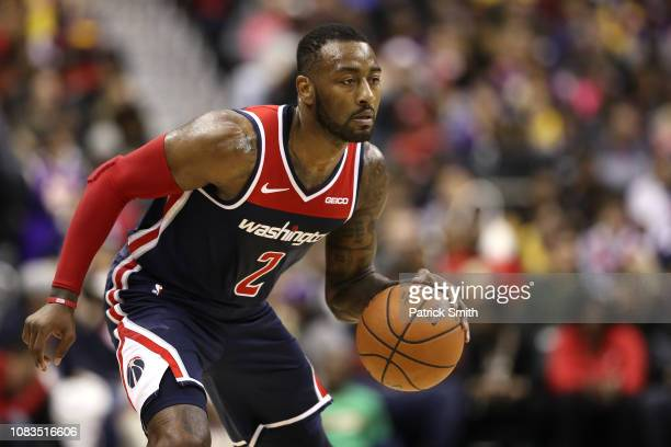 John Wall of the Washington Wizards dribbles against the Los Angeles Lakers during the second half at Capital One Arena on December 16 2018 in...