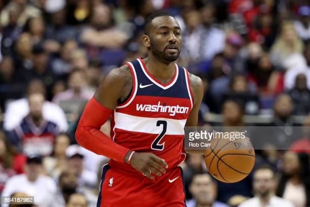 John Wall of the Washington Wizards dribbles the ball against the Detroit Pistons at Capital One Arena on October 20 2017 in Washington DC NOTE TO...
