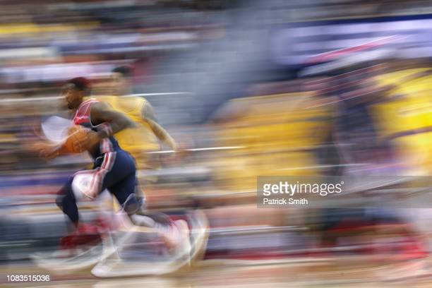 John Wall of the Washington Wizards dribbles to the basket against the Los Angeles Lakers during the first half at Capital One Arena on December 16...