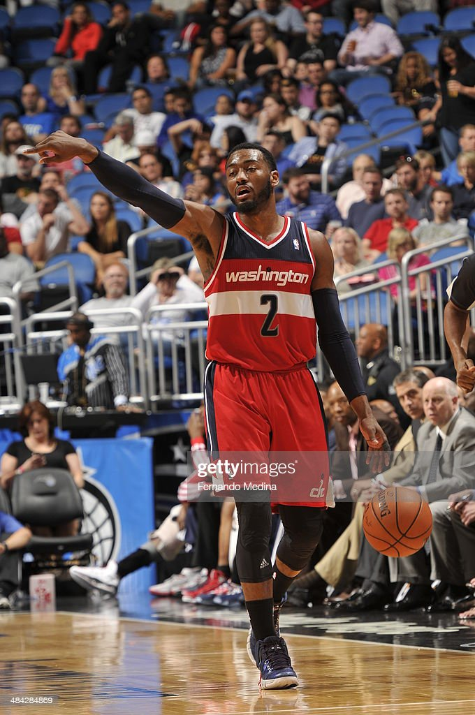John Wall #2 of the Washington Wizards dribbles up the court against the Orlando Magic during the game on April 11, 2014 at Amway Center in Orlando, Florida.