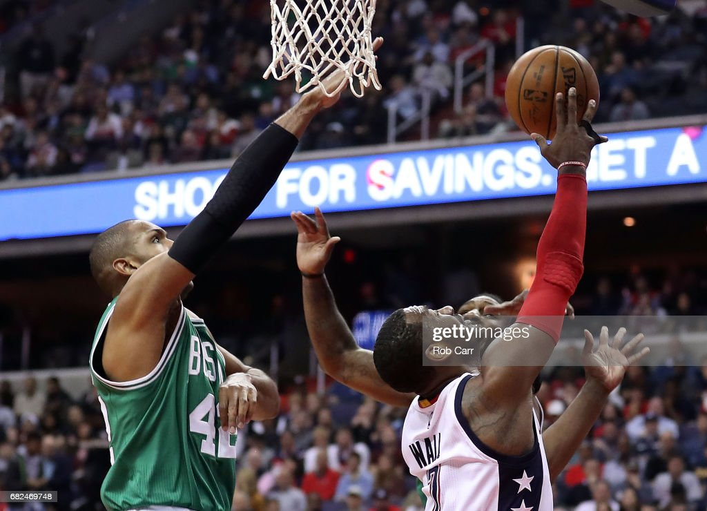 John Wall #2 of the Washington Wizards drives against Al Horford #42 and Jae Crowder #99 of the Boston Celtics during Game Six of the NBA Eastern Conference Semi-Finals at Verizon Center on May 12, 2017 in Washington, DC.