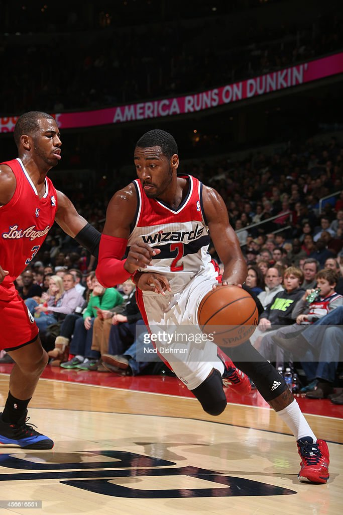 John Wall #2 of the Washington Wizards drives against Chris Paul #3 of the Los Angeles Clippers during the game at the Verizon Center on December 14, 2013 in Washington, DC.