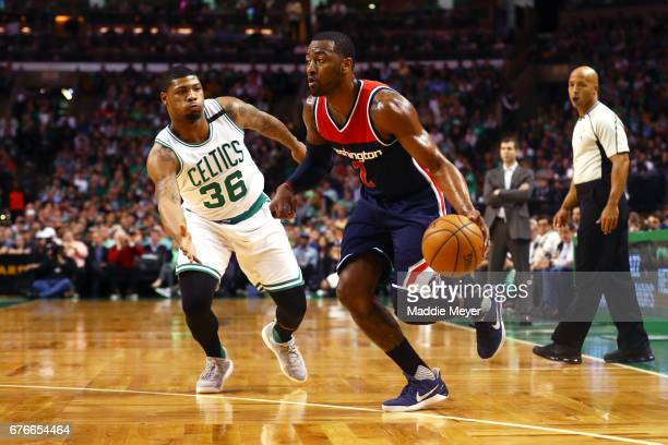 John Wall of the Washington Wizards drives against Marcus Smart of the Boston Celtics during the first quarter of Game Two of the Eastern Conference...