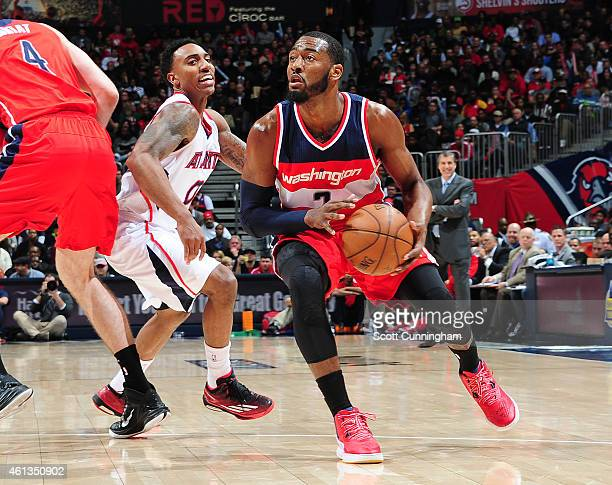John Wall of the Washington Wizards drives against the Atlanta Hawks on January 11 2015 at Philips Arena in Atlanta Georgia NOTE TO USER User...