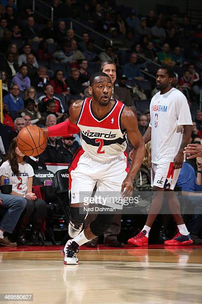 John Wall of the Washington Wizards drives against the Sacramento Kings at the Verizon Center on February 9 2014 in Washington DC NOTE TO USER User...