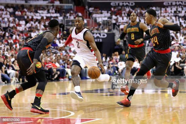 John Wall of the Washington Wizards drives the basket against the Atlanta Hawks in Game One of the Eastern Conference Quarterfinals during the 2017...