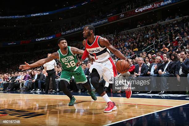 John Wall of the Washington Wizards drives to the basket against Marcus Smart of the Boston Celtics on December 8 2014 at the Verizon Center in...