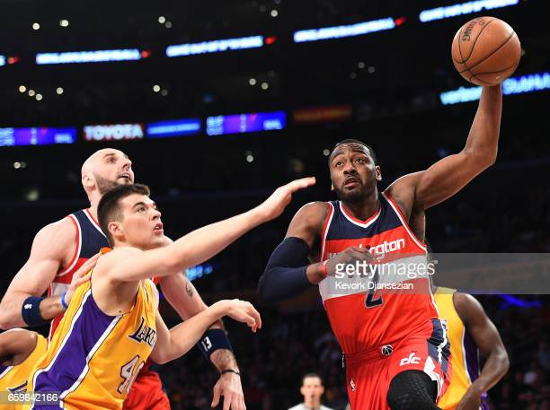 John Wall of the Washington Wizards drives to the basket against Ivica Zubac of the Los Angeles Lakersduring the first half of the basketball game at...