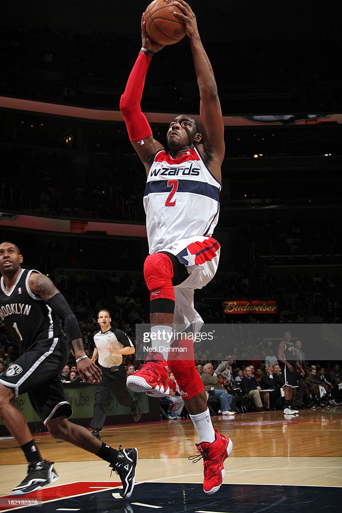 John Wall #2 of the Washington Wizards drives to the basket against the Brooklyn Nets on February 8, 2013 at the Verizon Center in Washington, DC.
