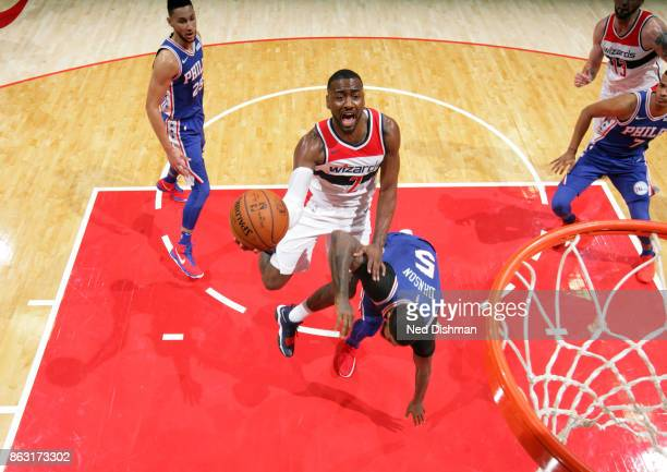 John Wall of the Washington Wizards drives to the basket against the Philadelphia 76ers on October 18 2017 at Capital One Arena in Washington DC NOTE...