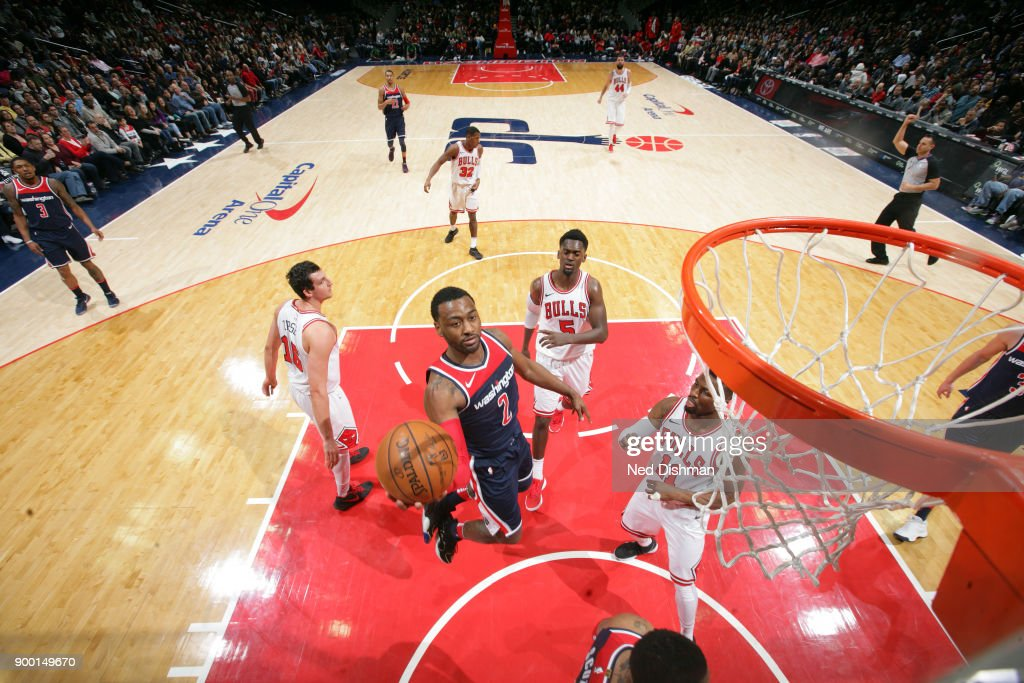 John Wall #2 of the Washington Wizards drives to the basket against the Chicago Bulls on December 31, 2017 at Capital One Arena in Washington, DC.