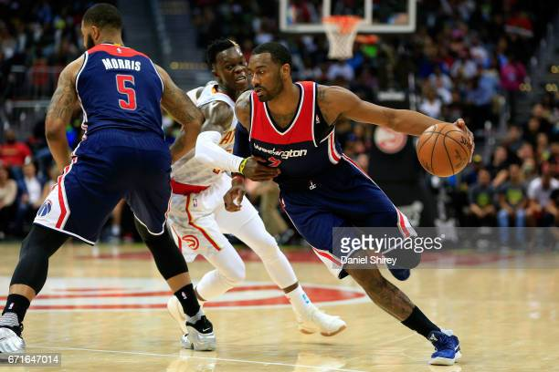 John Wall of the Washington Wizards drives to the basket during the fourth quarter against the Atlanta Hawks in Game Three of the Eastern Conference...