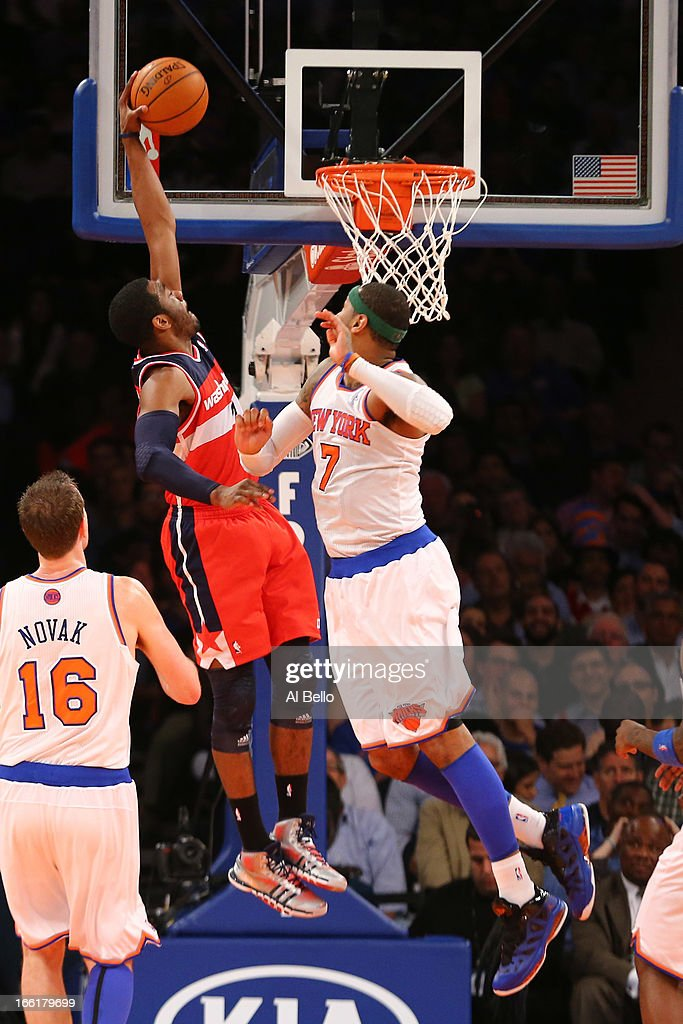 John Wall #2 of the Washington Wizards dunks against Carmelo Anthony #7 of the New York Knicks during their game at Madison Square Garden on April 9, 2013 in New York City.