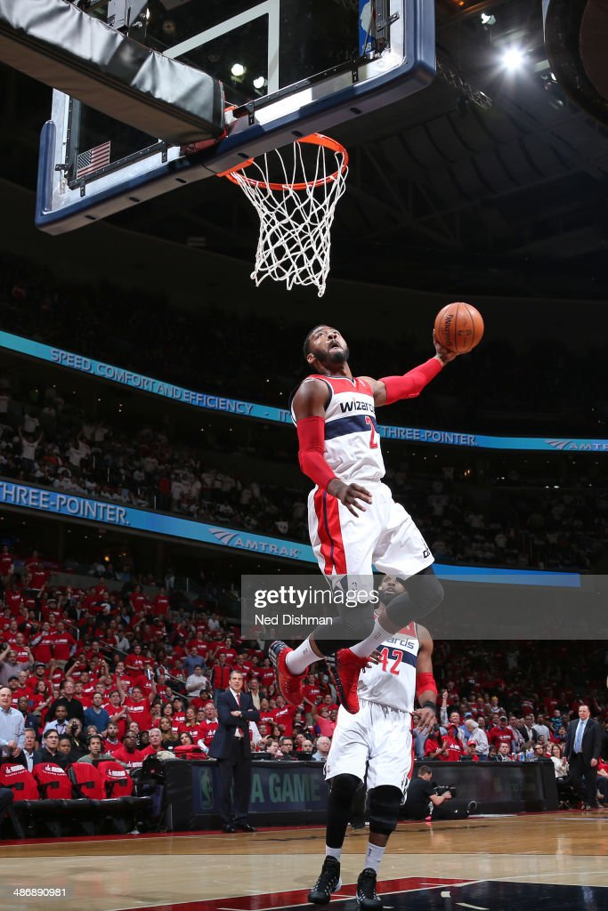 John Wall #2 of the Washington Wizards dunks against the Chicago Bulls in Game Three of the Eastern Conference Quarterfinals during the 2014 NBA Playoffs at the Verizon Center on April 25, 2014 in Washington, DC.